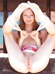 Skinny Gloria gets naughty on the swings showing her innocent body